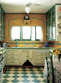 1930's kitchen. Normally I wouldn't think green and yellow would mesh, but this is lovely.