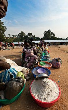 Women selling cassava flour at Gety's market, Democratic Republic of Congo.