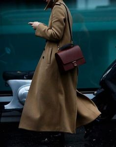 burgundy handbag and olive wool coat