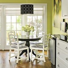 dining rooms - Valspar - Bella Mint - lime green black white  Green walls, white, kitchen, cabinets, black granite countertops and wood floors.