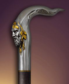 Silver and gold walking stick