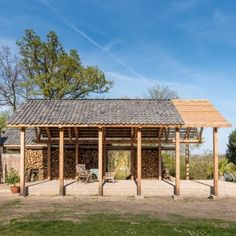 DeBossa+installs+split-level+timber+pavilion+in+the+grounds+of+a+Dutch+mansion