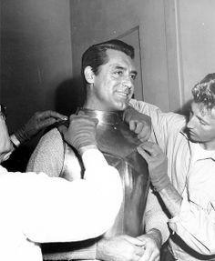 "Cary Grant being put into his ""knight in shining armor"" suit for ""The Bachelor and the Bobby-Soxer"" (1947)."