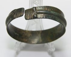 Ancient Viking  bronze   bracelet.   Dragon's head