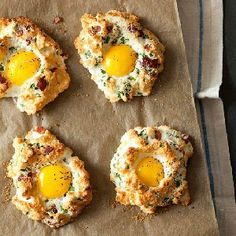 Eggs in Clouds! Egg whites are whipped with cheese and bacon to form the super fluffy shell for a perfect runny yolk.