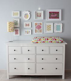 Mismatched white frames with scrapbook paper