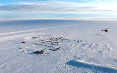 A U.S. Antarctic Program helicopter circles the Pine Island Glacier field camp.
