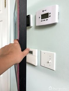 Looking for ideas to hide a thermostat or other eye sores on your wall? This DIY abstract painting is easy to make and when installed correctly can easily cover up your thermostat and still easily access it. Looking for ideas to Hide Thermostat, Thermostat Cover, Affordable Furniture, Affordable Home Decor, Abstract Canvas Art, Hanging Art, Vintage Home Decor, Diy Wall, Diy Painting