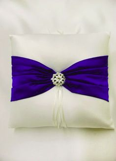 Perfect pillow for the little ring bearer!  Matches the basket for the flower girl!  Horizon Blue and White.  $29.00 From David's Bridal (http://www.davidsbridal.com/Product_DB-Exclusive-Splendor-Ring-Bearer-Pillow-P618W).