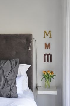 i like the Ms along the side of the bed. could use Bs on brian's side.