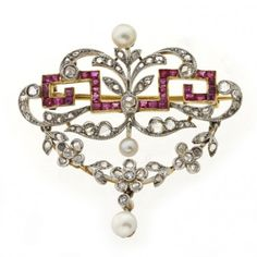 An Edwardian ruby, pearl and diamond swag brooch, circa 1900