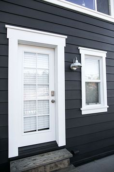 Door & Window Trim - black and white benjamin moore exterior paint and industrial sconce light / sfgirlbybay Black House Exterior, Exterior Paint Colors For House, Paint Colors For Home, House Colors, Paint Colours, Dark Siding House, Cabin Paint Colors, Siding Colors For Houses, White Siding