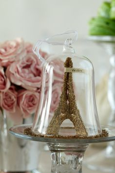 Eiffel Tower Favors. Combine cake stands with glass bell jars and a classic icon for a unique baby shower memento.