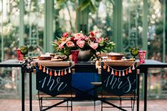Edgy Garden Wedding - Reception Decor Inspiration with black, pinks, and wood. Chalkboard lettering Mr and Mrs Chair signs with tassels
