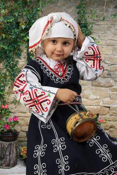 Bulgaria. Little girl in traditional dress.