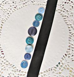 blue buttons black ribbon