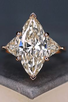 27 Engagement Ring Shapes and Cuts - Total Jewelry Photo Guide ❤️ engagement ring shapes diamond marquise cut three stones ❤️ See more: http://www.weddingforward.com/engagement-ring-shapes/ #weddingforward #wedding #bride