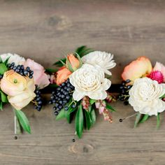 Beautiful berry boutonnieres | Laura Murray Photography |  Bare Root Flora | www.theknot.com