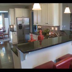 Kitchen! Love the white cabinets, dark counters, and dark floor!!!