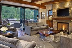 The great room of the Heart of Telluride penthouse in downtown Telluride, CO opens up to a fabulous deck with spectacular views.