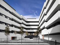 Image 1 of 14 from gallery of 44 Social Housing / Magén Arquitectos. Photograph by Jesús Granada Granada, Social Housing Architecture, City Block, Terrace, Facade, Multi Story Building, Patio, Interior Design, Gallery