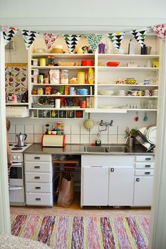 Sweet, simple kitchen. I actually like the open cabinets. Holding one accountable for healthy options perhaps?? :-)