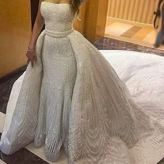 This beaded wedding gown can be made for less than you think. We are dress makers located near Dallas Texas who produce custom #weddingdresses for brides all over the globe. Brides can also request us to make inexpensive #replicas of couture designs for less. Get pricing on any design at www.dariuscordell.com