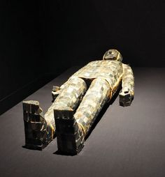 Jade burial suit.  Jade has a long history in China which can date back to the early Neolithic period (about 5000 BC). In ancient China, it was associated with virtue, as Confucius said there are 11 De (virtue) in jade. It also symbolized grace and dignity. Only high officials can be buried with jade objects.