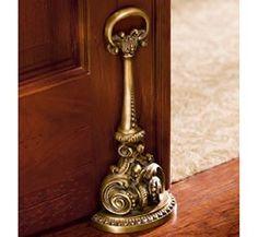 Lavish Brass Door Stop. No info - will post when I find it...