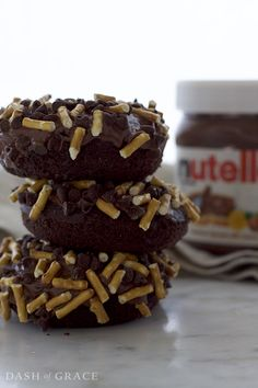 Nutella Dark Chocolate Salted Pretzel Donuts Recipe -Rich, fluffy, dark chocolate cake donuts dipped in a creamy, chocolatey, Nutella glaze and topped with crunchy, salted pretzel pieces and delectable, mini chocolate morsels @worldmarket