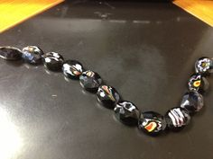one strand of swirly black and white glass beads