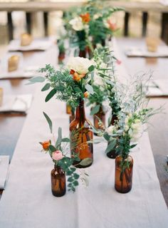 Simple but beautiful wedding centerpieces ideas using wine bottles (3)
