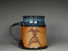 Bring on the laughs with this handmade durable stoneware mug. This grouchy guy holds 16 oz. of your favorite beverage and is sure to cheer up even the toughest case of the doldrums. Yes, this is anger management at its best!  My name is Richard Scarbrough and my studio is located in the foothills of the Ozark Mountains. Ive been making pottery for almost 40 years and throughout those years Ive been perfecting the faces that bring laughter wherever they go. This is the original Grumpy Mug…