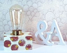 Mid-century modern lighting with Edison bulb lamp painted in ivory color and decorated with hand painted circles pattern in brown and yellow colors.