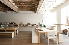 Benches-Dining-chairs-Dining-tables-Dinnerware-Exposed-beams-Light-airy-Open-floor-plans-Open-shelving-Restaurants-Wood-floors : Gallery Image : Remodelista