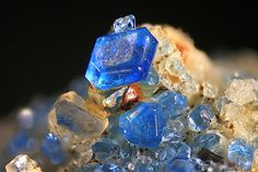 Cluster of transparent, blue & rounded haüyne crystals with sanidine. Copyright © Volker Betz (2014)
