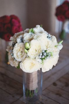 possibly better to do white flowers with some blue in them to refer to the girls' dresses