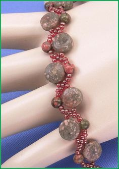 05338 Red and Brown Seed Bead with Unakite by annsbeadedjewelry, $25.50