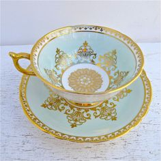 Vintage 1960's Paragon Pale Blue With Gold,Tea Cup Saucer. Bone China made in England.via twolittleowls, etsy