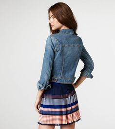 pleated skirt and jean jacket.