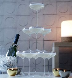 Champage Tower Party Set: The ultimate party centrepiece for celebrations and weddings, this set of ten elegant champagne saucers allows champagne to cascade from layer to layer when stacked in tiers. The tower of coupe-shaped glasses is designed to hold one magnum of champagne or two standard bottles.