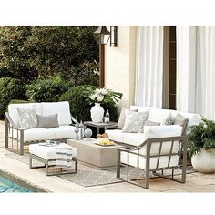 With its airy architectural frames, wide sloping arms and deep, lounging comfort, our Sullivan Outdoor Collection promises picture perfect weekends. The Sofa is made of extremely strong, yet lightweight aluminum with outdoor-safe warm gray finish. Sullivan Sofa features: Off-white cushions includedFully assembledReplacement cushions available