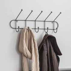Add a touch of industrial design to the hallway, utility room or bedroom with the Farringdon Hook Rail. Hand welded in Steel, the simple, sturdy structure with five hooks is finished with a matt laminate lacquer. Oak Shelves, Shelving, Vintage Coat Hooks, Hanging Scarves, Hat And Coat Hooks, Under Stairs Cupboard, Steel Metal, Hallway Decorating, Industrial Design
