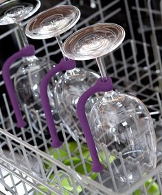 Protect wine glasses in the dishwasher with this flexible plastic tether rod! Special clasps clip to the stem of each wine glass, and adjustable sizing promises to fit stemware of all shapes and sizes.