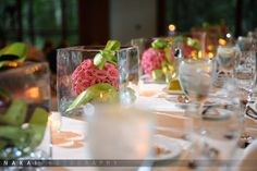 awesome use of ceremony aisle flowers used along the head table at the reception.  vale of enna