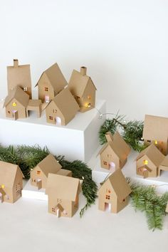 Christmas Advent Paper Houses (+ Silhouette Cameo Giveaway Christmas Advent Paper Houses – free tutorial and cutting files // Delia Creates Noel Christmas, Christmas Paper, Christmas Crafts For Kids, Simple Christmas, Holiday Crafts, Paper Christmas Decorations, Xmas, Homemade Christmas, Christmas Ideas