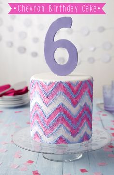 This cake has hand-made appeal thanks to the stitched look of brushed embroidery. Create the exciting purple and pink color scheme using the Color Right Performance System.
