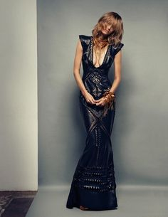 The model wears leather Gaultier Paris gown with hand-cut patterns and brass necklace and bracelet