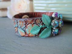 Leather cuff, upcycled belt bracelet 'Flora', turquoise, purple, vintage rhinestone flower, tooled leather, resort wear, country chic. $88.00, via Etsy.