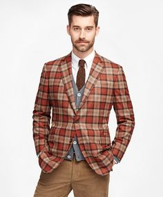 This sport coat is made from pure wool woven in Italy. Offered in our trimmer Regent fit it features slimmer lines and higher armholes. Three-button tip-over with side vents. Soft, lightweight construction gives a relaxed look and feel. Dry clean. Imported.